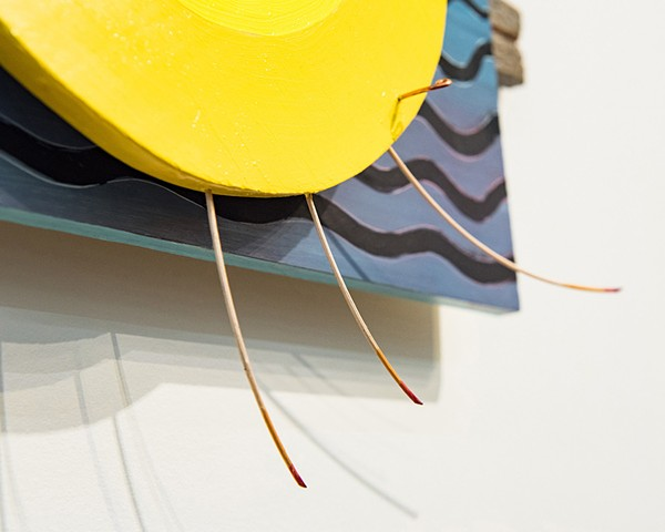 Kinetic sculpture spins by way of human interaction, painted in oil and drawn on