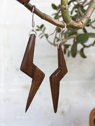 Hand made earrings from wood and metal. Lightning, light and oh so speedy.