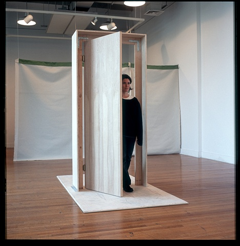 The participant comes in or out through the swinging door, physically and symbolically demarcating space and state of mind