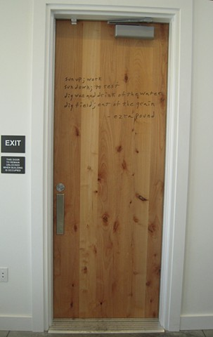 ezra pound quote on a wooden door. interpretive center, hailey, idaho