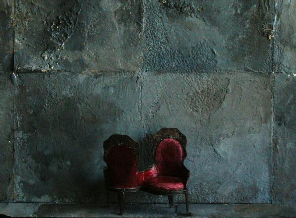 Model: Half inch Victorian Chair against cement.