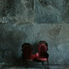 Model: Half inch Victorian Chair against cement.