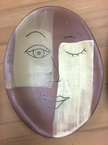 slab formed stoneware platter with slip and inlay decoration
