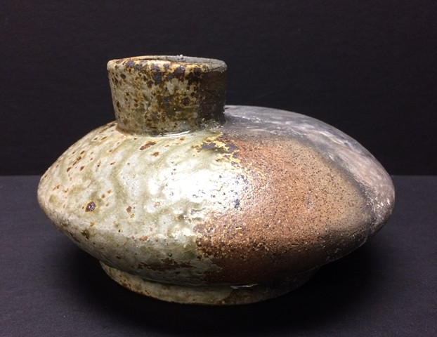 Thrown Bottle form fired in reduction with charcoal Injection