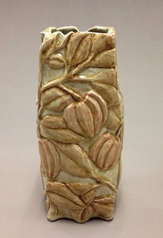 hand carved stoneware vase with clear glaze and under glaze colorants