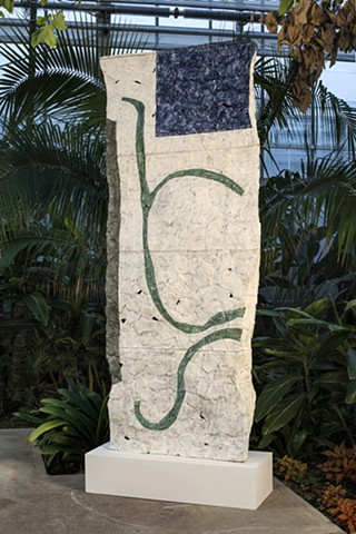 painted ceramic sculpture in botanical garden