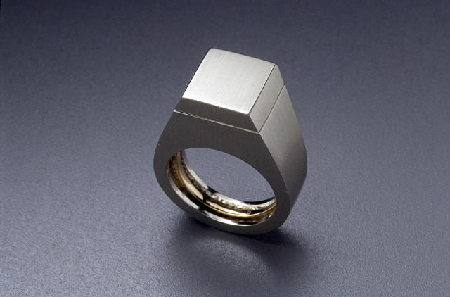 'Gents' Ring - with interior solitaire engagement ring (closed position)