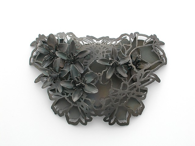 Steel jewelry, Steel brooch