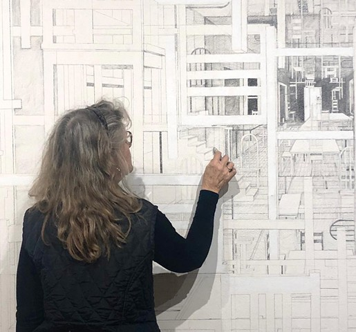 Sheila Ghidini drawing on the gallery wall during the installation of From Here to There.