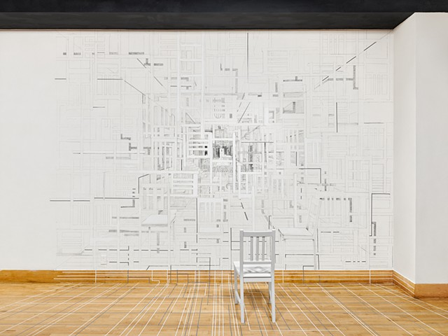 A site-specific installation presented at San Francisco State University Gallery created by Sheila Ghidini.  A graphite wall drawing depicts parts of the interior site and a found chair is drawn into the composition as well as placed in front of the drawi