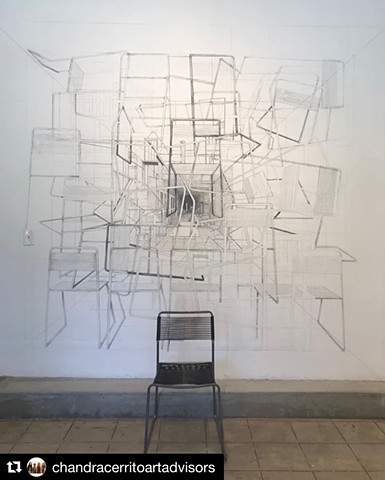 A site specific installation utilizing a found chair at the site and graphite wall drawing.  Inspired by short story by Borges about a point that contains all other points in space, The Aleph.