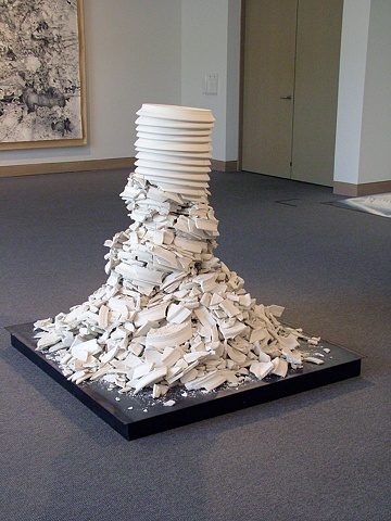 100 handmade porcelain plates, stacked