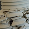 100 handmade porcelain plates, stacked (detail)