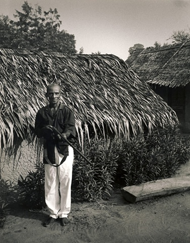 Man with Rifle, Ivory Coast, Africa
