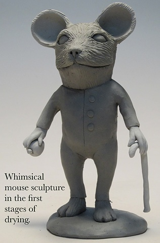 Drying decorative mouse sculpture.