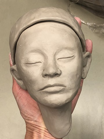 Clay wall faces being sculpted in cone 6 hand building clay. My goal is to make 100 individual clay wall faces by the new year.
