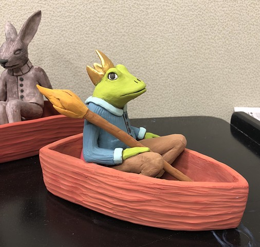 A good day for painting these clay boat figures.