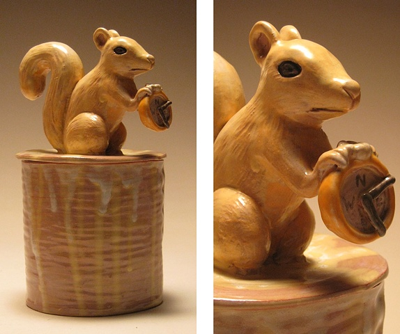 Squirrel Vessel holding compass.  (Lidded vessel form)