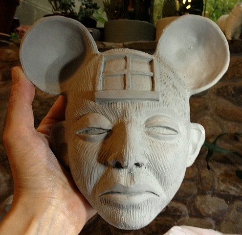 Clay mask being dried out before kiln firing.