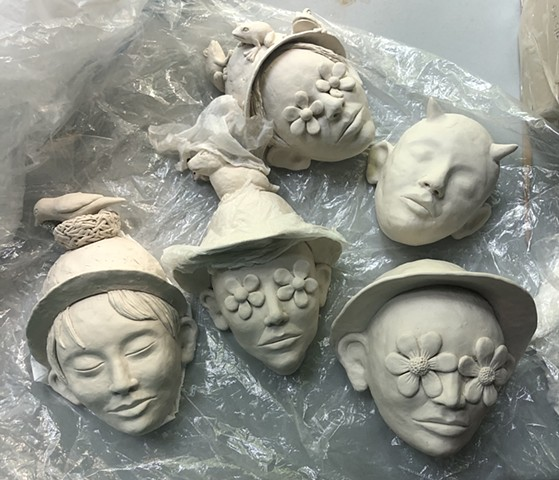 Paper clay wall pieces in progress.