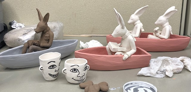 Rabbits in boats being glazed.