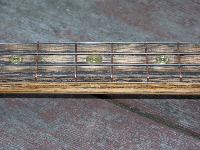 Bullet guitar - inlaid shell casing fret markers