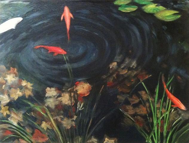 Fall leaves on a deep koi pond