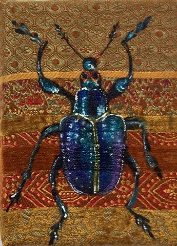 scarab beetles have been portrayed since ancient Egypt as a symbols of good luck