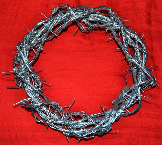 "John 19.2 ""The soldiers twisted together a crown of thorns and put it on his head."" Thorns represent curses throughout the scriptures and Jesus took all the curses of the world upon his head so we don't have to."
