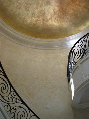 Gold leaf dome ceiling, damask stencil on walls, and antiqued moldings