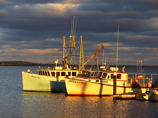 Sunset reflected on boats in Provincetown Harbor, Provincetown, MA © Sally Brophy