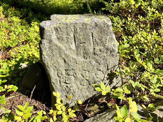 Corner stone in the Pine District.