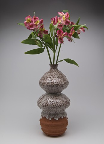 Torn Piece Vase with flowers