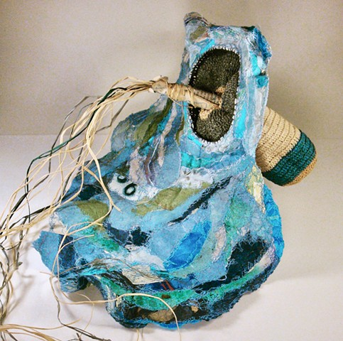 artist book, unconventional book, sculpture, container, soft sculpture,thread, sewn, patching with paper.