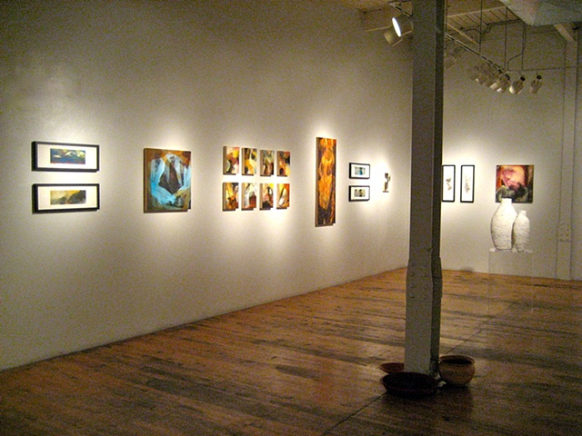 Another long view of the gallery space with works on display.