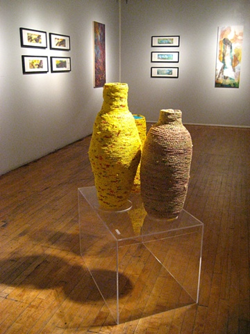 Closer up angle of vessels with paintings in the background.