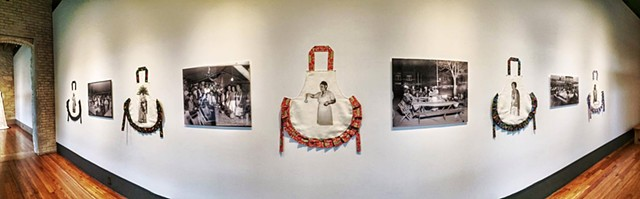 Installation view of the 5 festive aprons