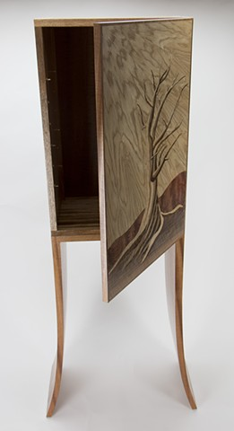 View of marquetry cabinet with door open