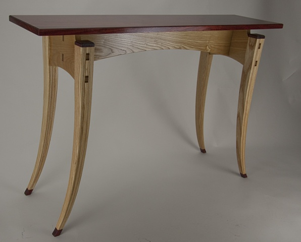 Paduak top table with laminated ash legs