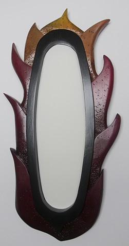 mirror with sculpted frame