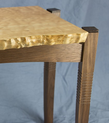 Detail of leg on curly maple table