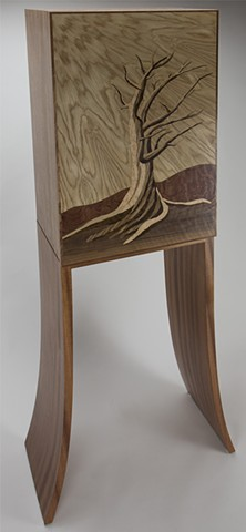 Three quarter view of marquetry cabinet