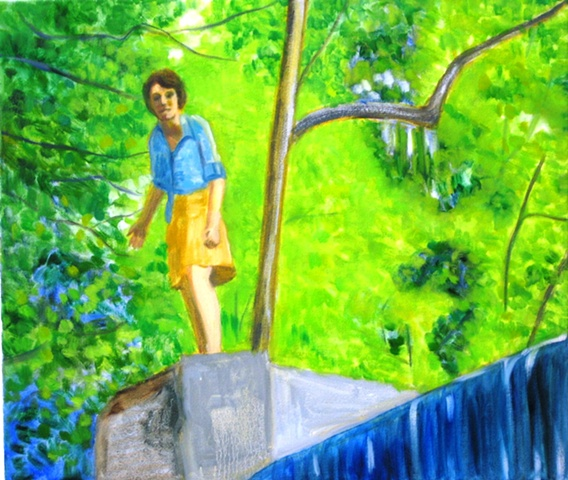 Standing on a cliff waterfall woman in the woods