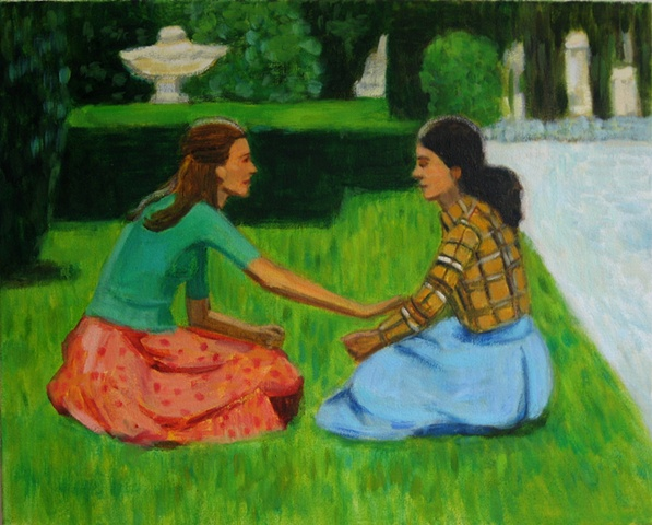 Two women in a field of grass in a park