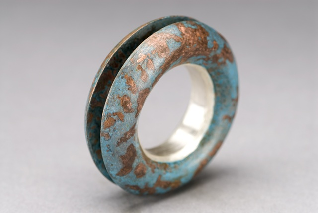 Convex die-formed ring w/ silver and copper.