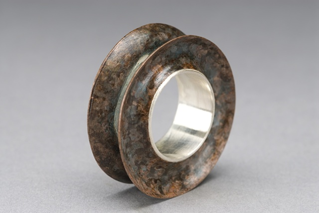 Concave die-formed ring w/ silver and copper.