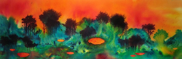 Pools reflect the orange evening sky like eyes in the hilly, forest landscape