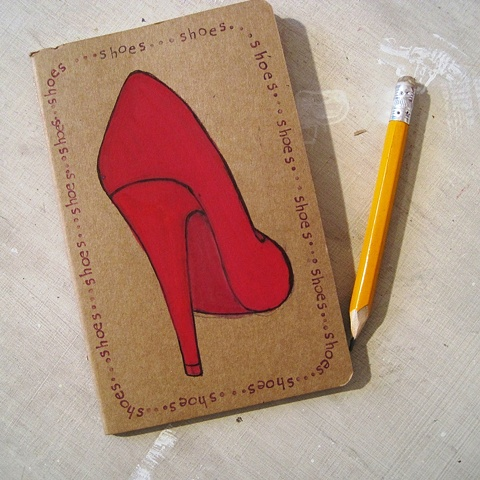Red Stiletto Shoe decorating the cover of a hand illustrated Moleskine Notebook, by Brighton artist, Linda Boucher