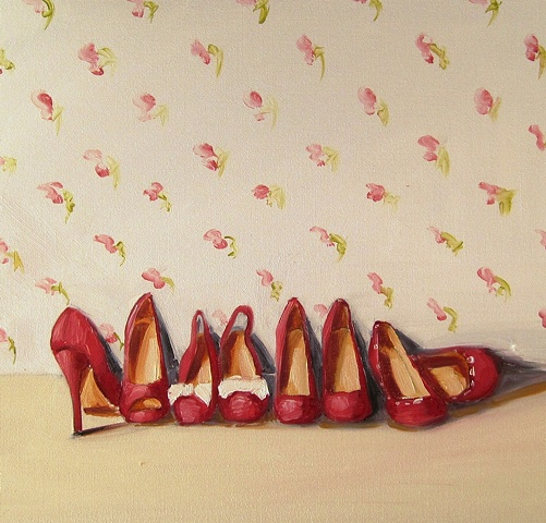 little red shoes with a vintage feel, painted against a rose covered wall. By Linda Boucher.