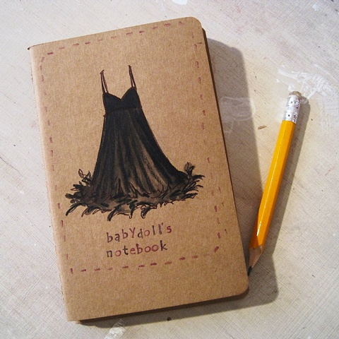 A little black babydoll dress adorns the cover of this little moleskine notebook. hand illustrated by brighton artist Linda Boucher.